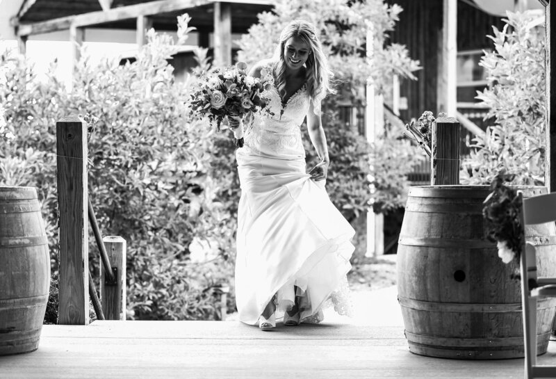 Bride enters the ceremony space at Quincy cellars wedding
