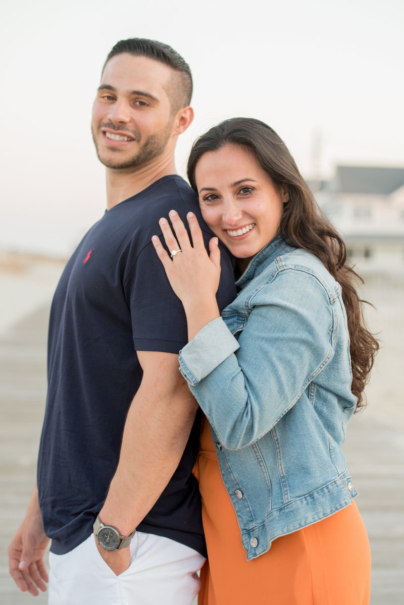 newly engaged portrait at lavallette boardwalk
