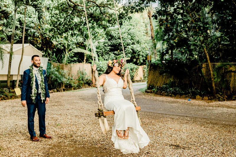 bride on swing at family formals at loulu palm in hawaii