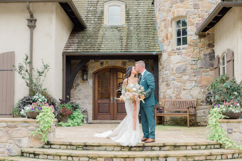 bride and groom kissing at French Inspired Private Estate wedding in charlottesville virginia by costola photography