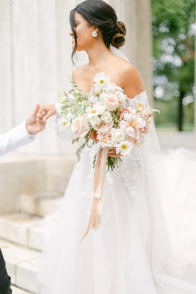 bride laughing holding bouquet at Washington DC Romantic Classic Wedding at the Lincoln Memorial by Costola Photography