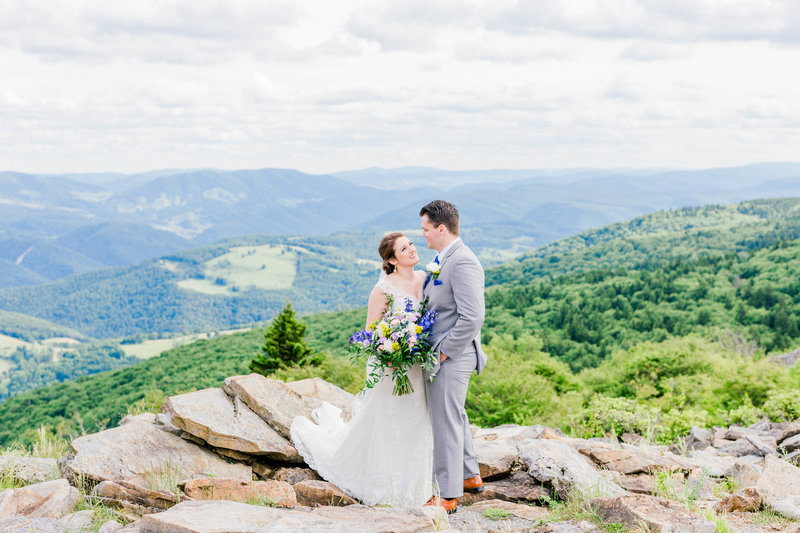Bride and Groom smile at each other on top of Spruce Knob in WV