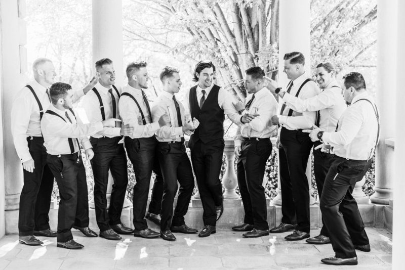 groomsmen on back porch of estate at at great marsh estate wedding in northern virginia by costola photography