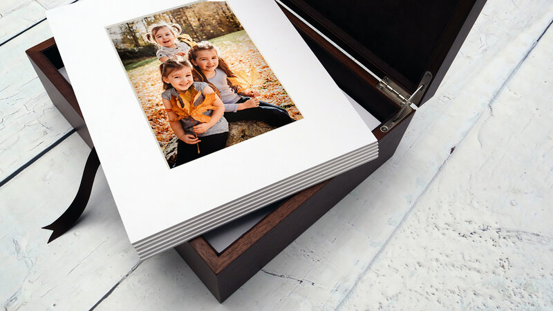 Box filled with matted printed photographs