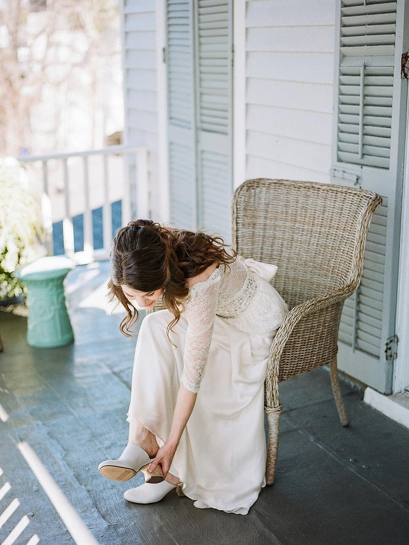 Bride putting on her wedding shoes before getting married