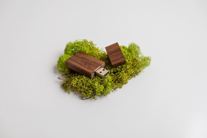 Dark Walnut Flash Drive nestled in moss. Green and brown, graduation pictures, pictures of family, graduation pictures, photographer in billings mt.