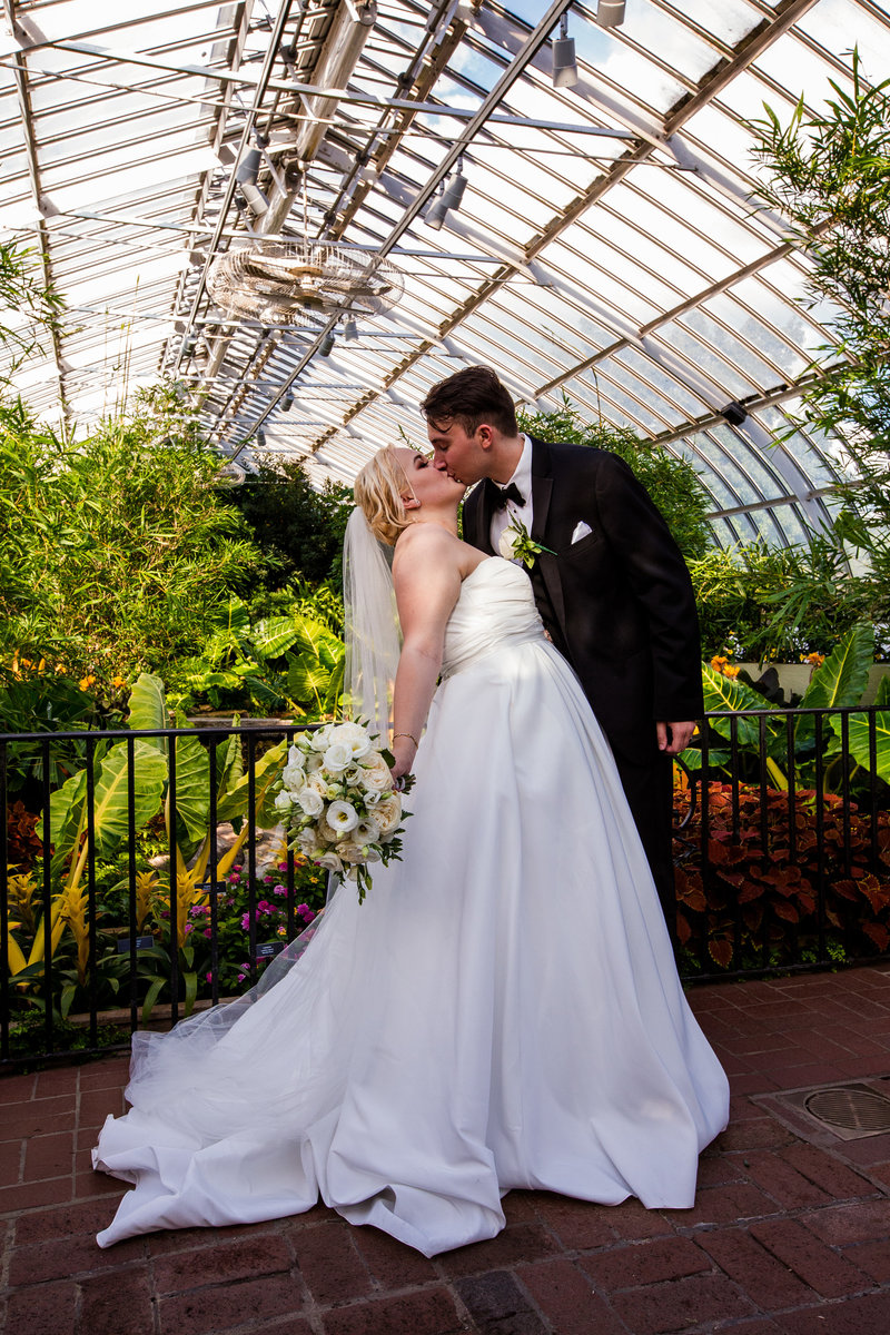Bride and groom kiss at Phipps Conservatory wedding