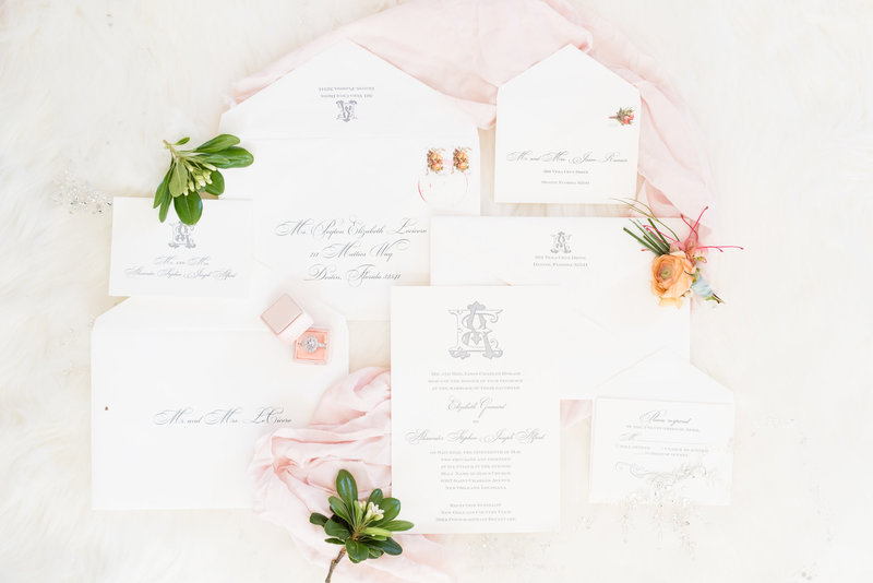 Blush and white invitation suite with greenery