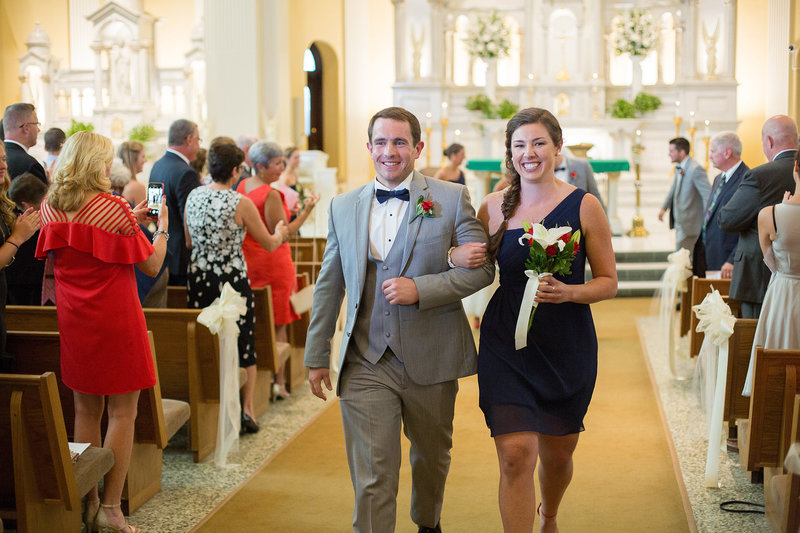 Recessional portrait of best man and maid of honor at St. Patrick's Church wedding