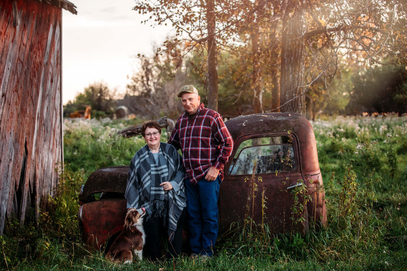couple and their dog with vintage truck