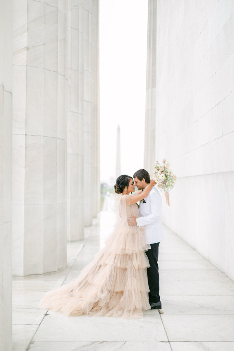 couple walking in navy yard in washington dc district winery wedding by costola photography