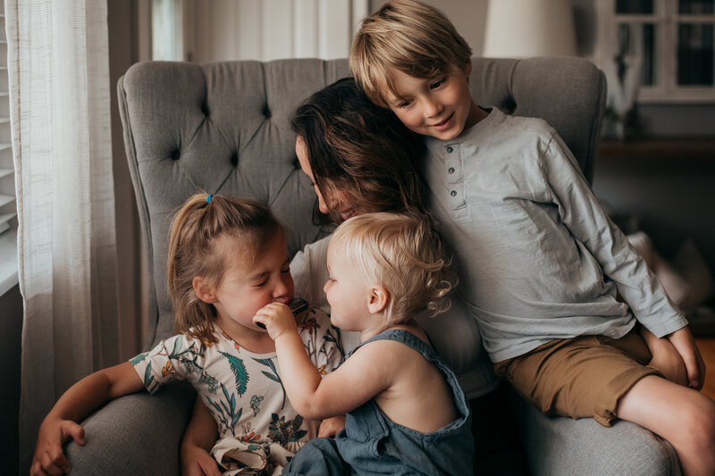 mom with 3 kids on chair