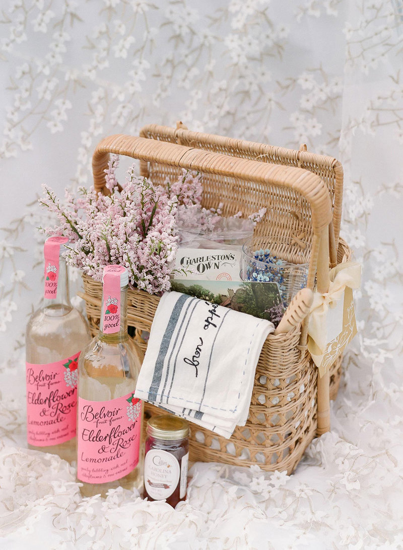 Picnic hamper with glass bottles and jars