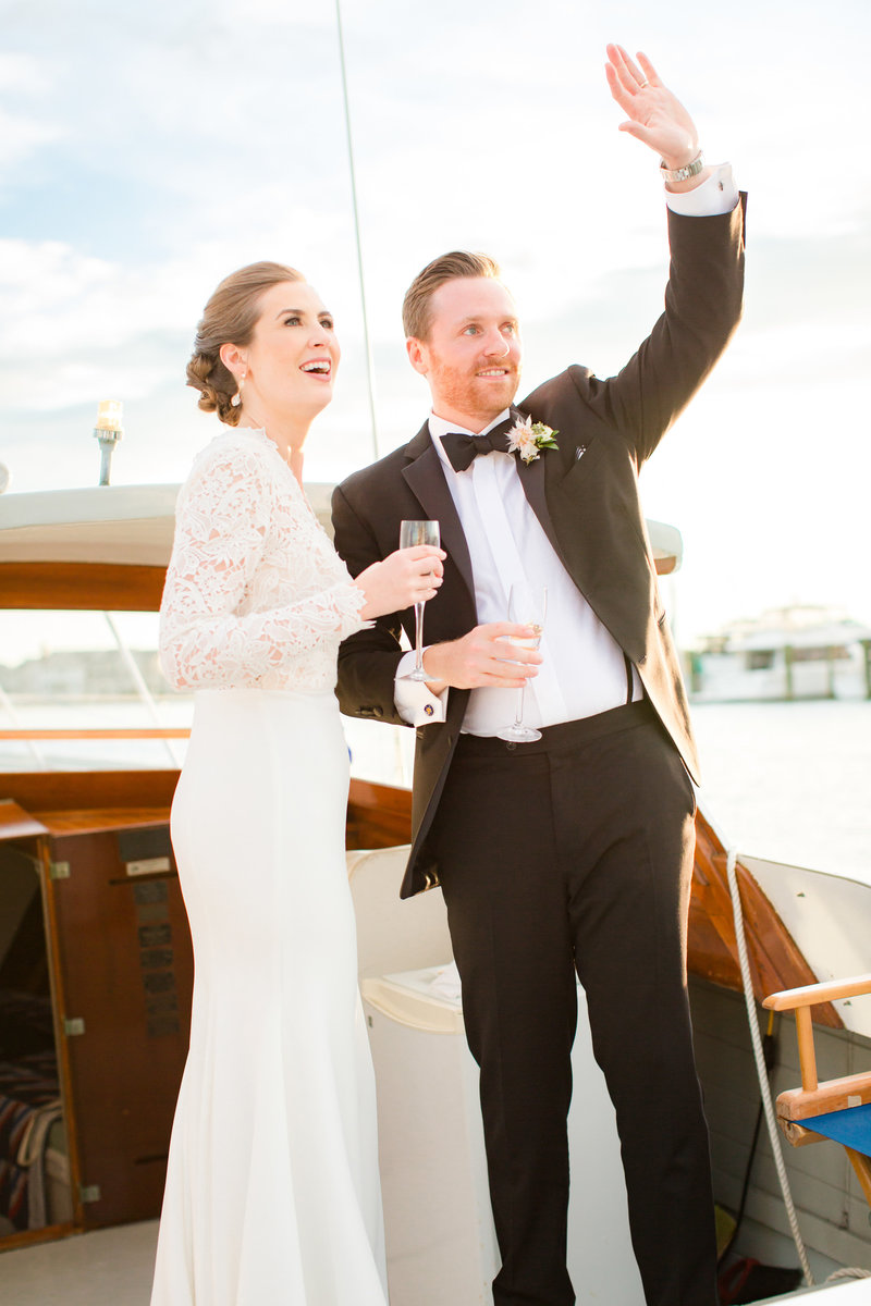 Joyful bride and groom on a boat