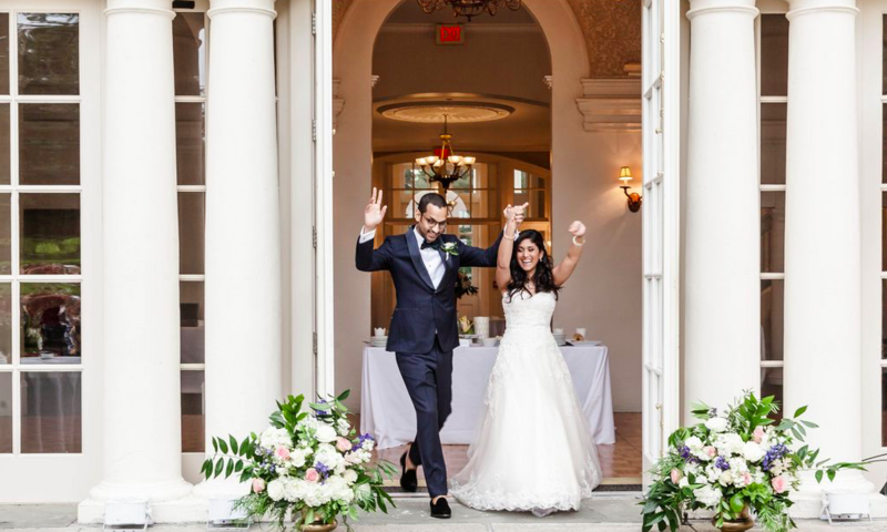 Wedding Couple Exiting Mansion in New England