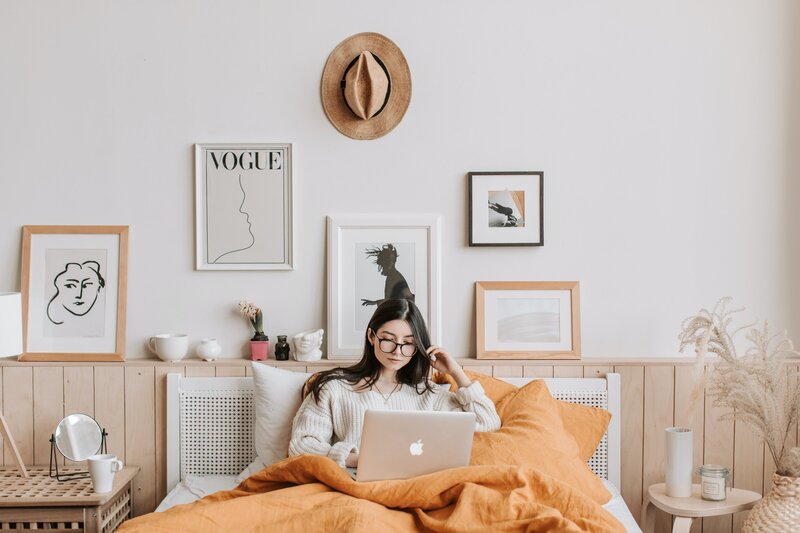 woman-using-laptop-in-bed-4050387