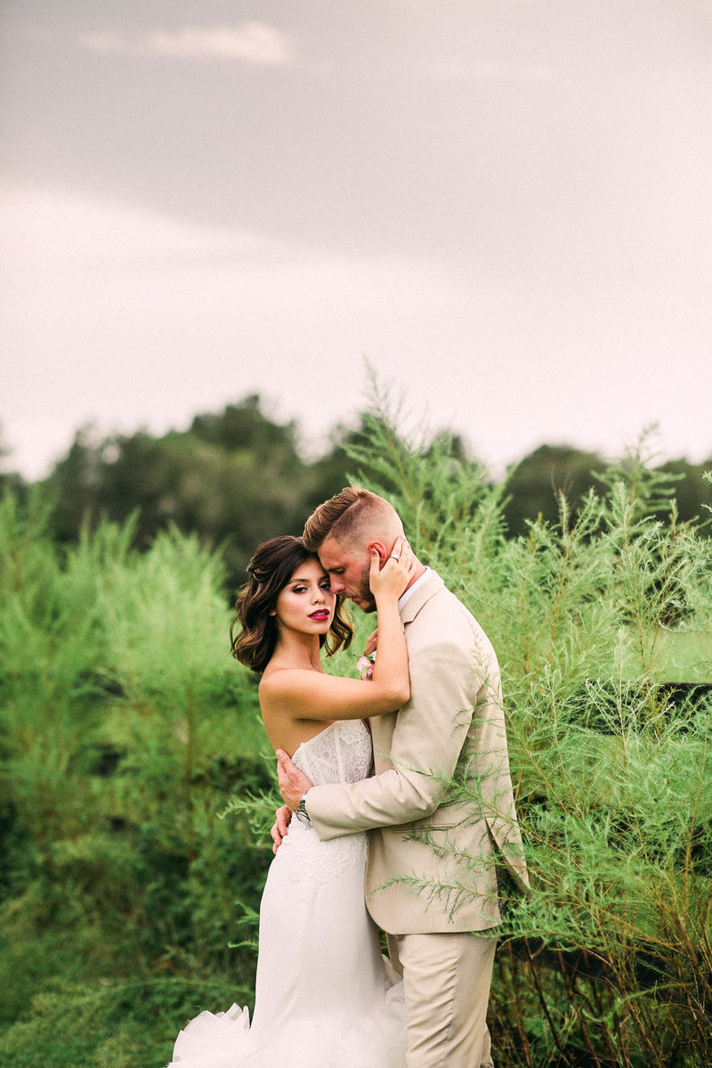 Bride and Groom next to pasture