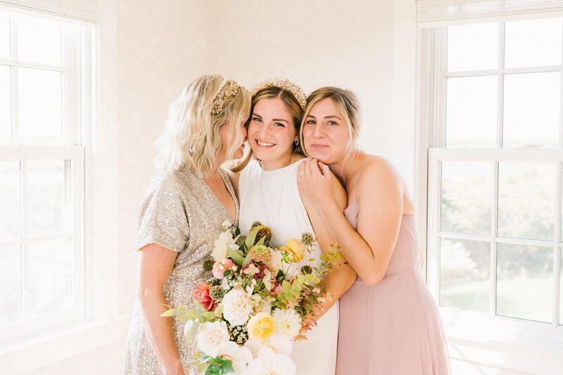 Aisha poses with her Mother and sister before her  intimate elopement on Miacomet Beach