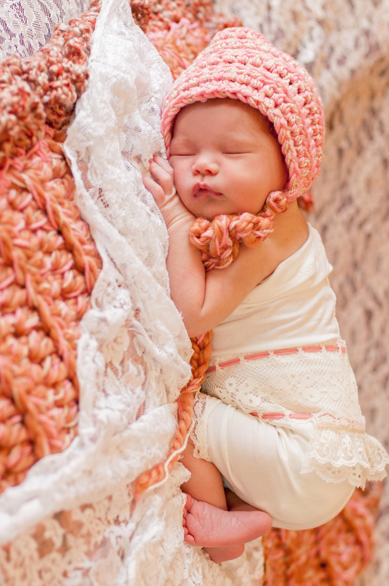 Newborn baby girl posing for photoshoot in Orange County, California