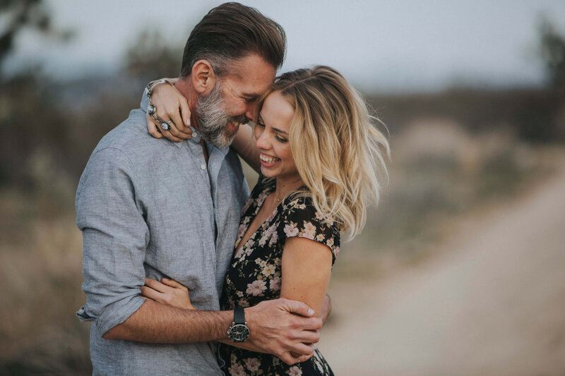 couple lovingly embraces in the desert