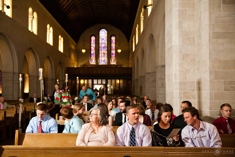 Wedding-Guests-Seated-in-Pews-in-Historic-Colorado-Springs-Shove-Memorial-Chapel
