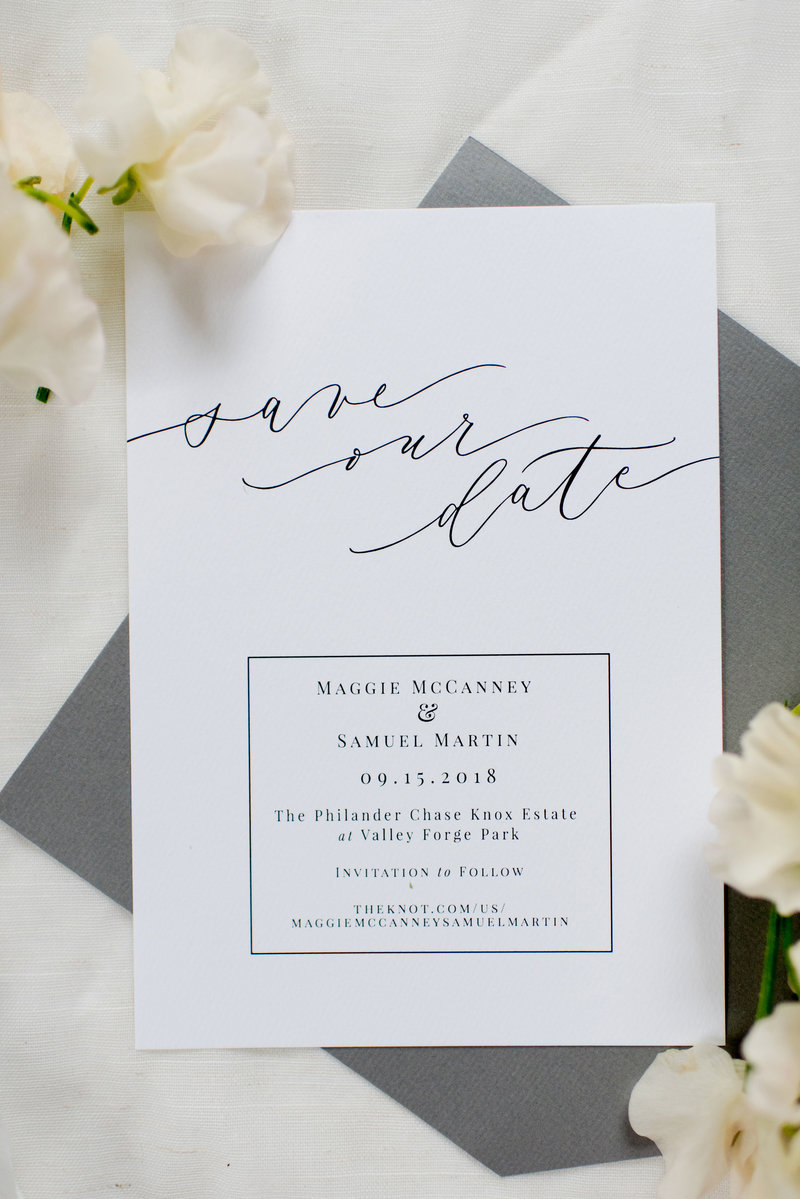 Modern save the date with custom calligraphy and dark ink