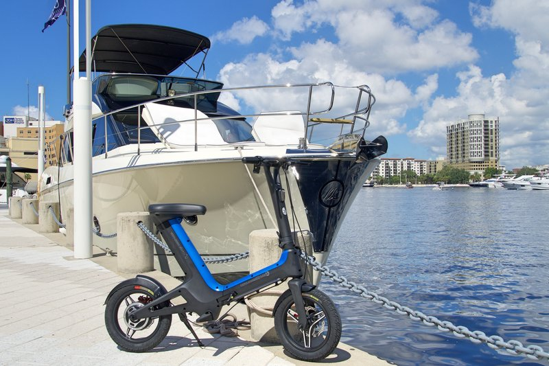 Blue Go-Bike M3 with Yacht in the background; V&D Electric Bikes