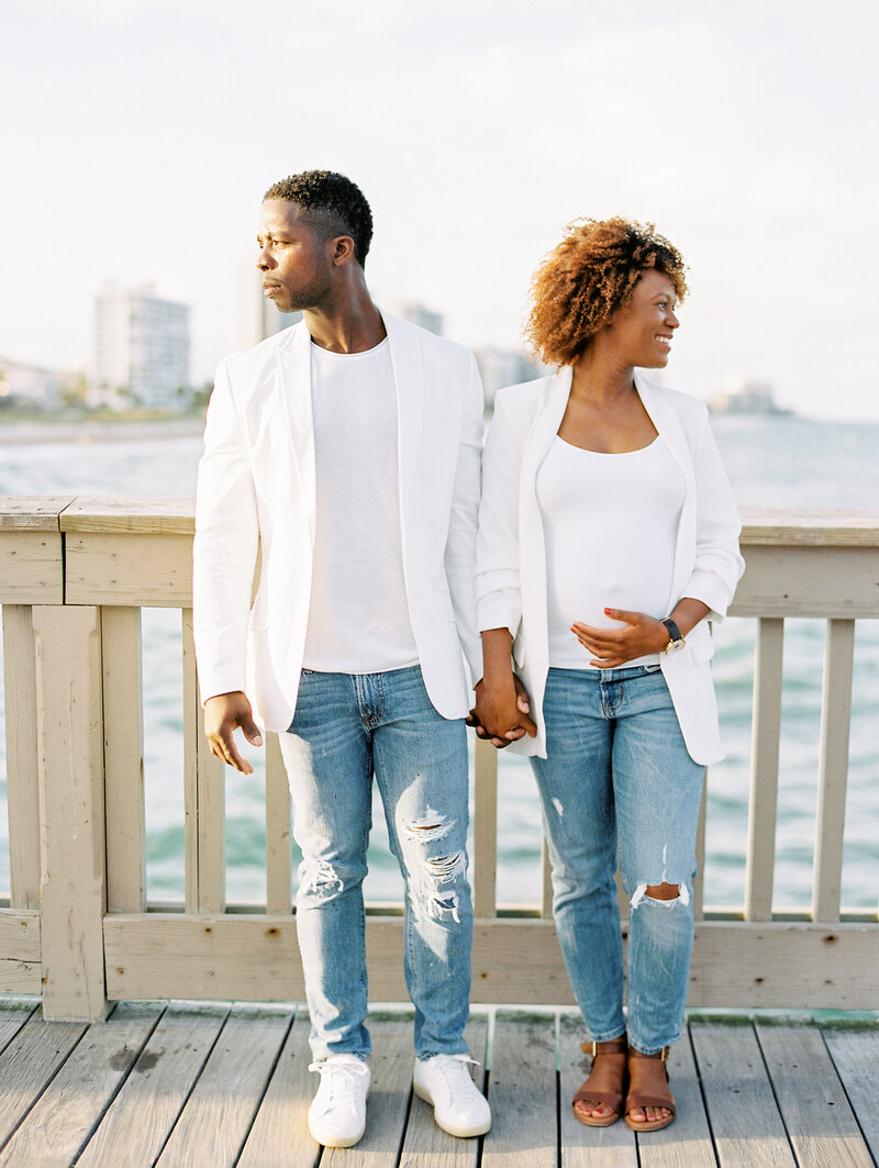 modern maternity session on the pier