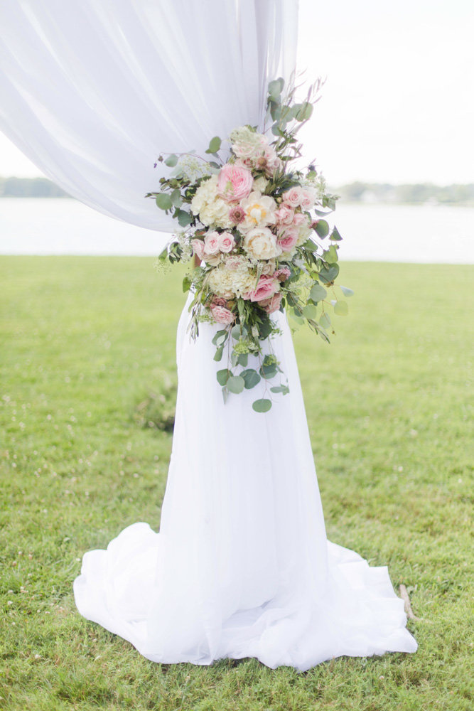 florals on ceremony arbor at eastern shore wedding at kirkland manor by costola photography