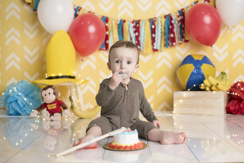 columbus ohio cake smash photographer first birthday session curious george baby boy