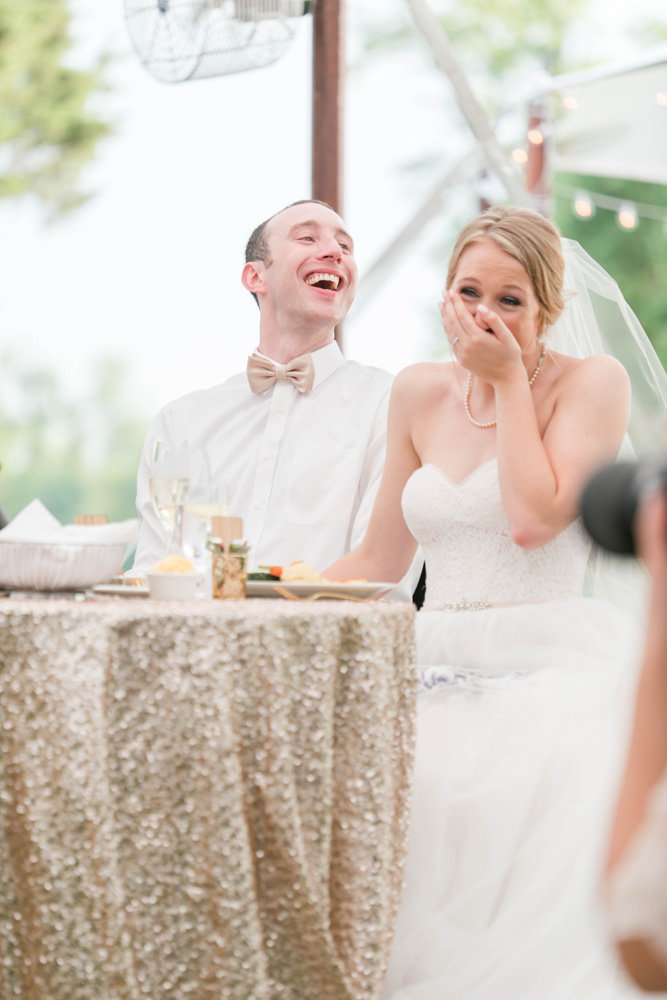 bride and groom laughing at toasts at eastern shore wedding at kirkland manor by costola photography