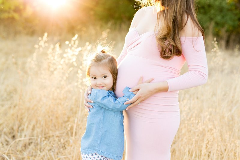 Maternity photography with sibling older child