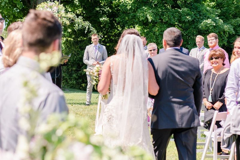 ciccone-vineyard-wedding-traverse-city-groom-sees-bride