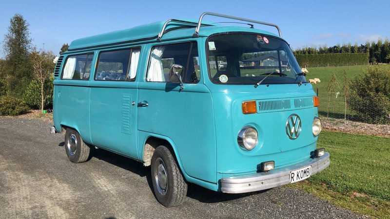 Right hand side and front on view of Rhonda, teal retro kombi van from NZ Kombi Hire