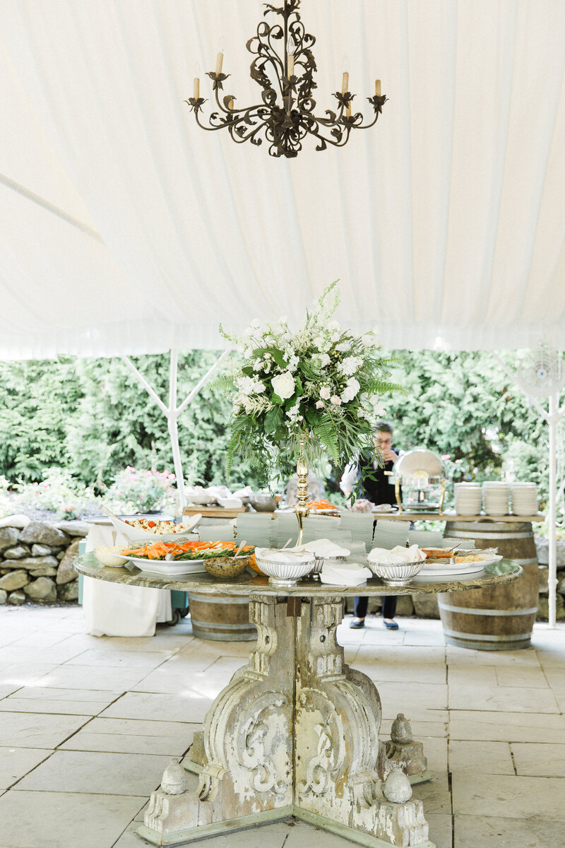 Beautifully displayed appetizers table at tented wedding reception