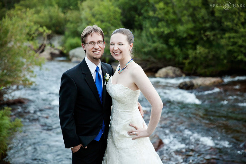 Wedding-Portraits-next-to-river-at-Wild-Basin-Lodge-in-Allenspark-CO