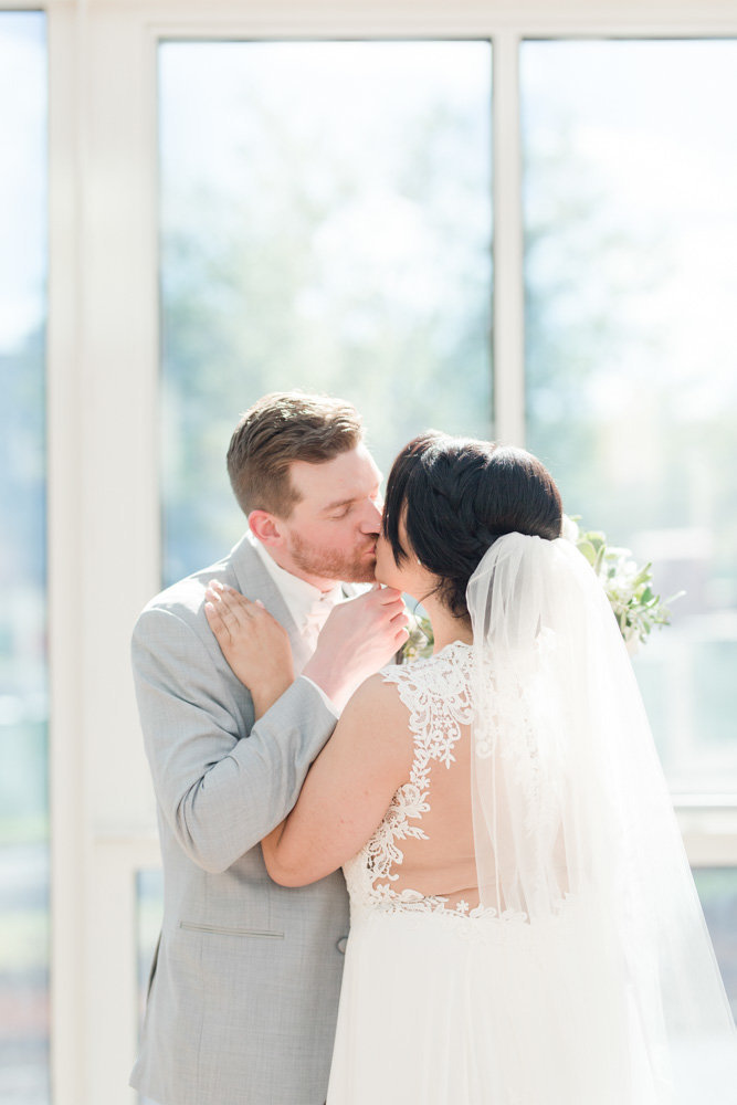 bride and groom kissing  at Stone House at Stirling Ridge Maryland Wedding by  Costola Photography
