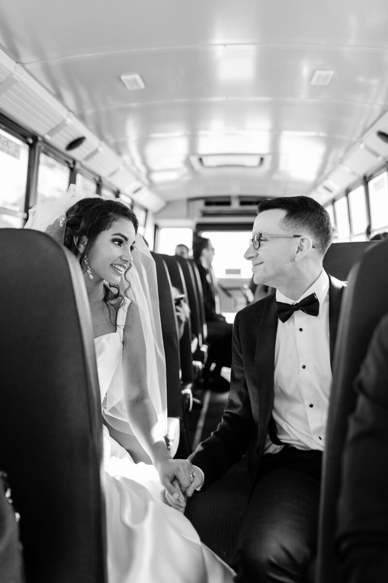 bride and groom in a school bus heading to venue