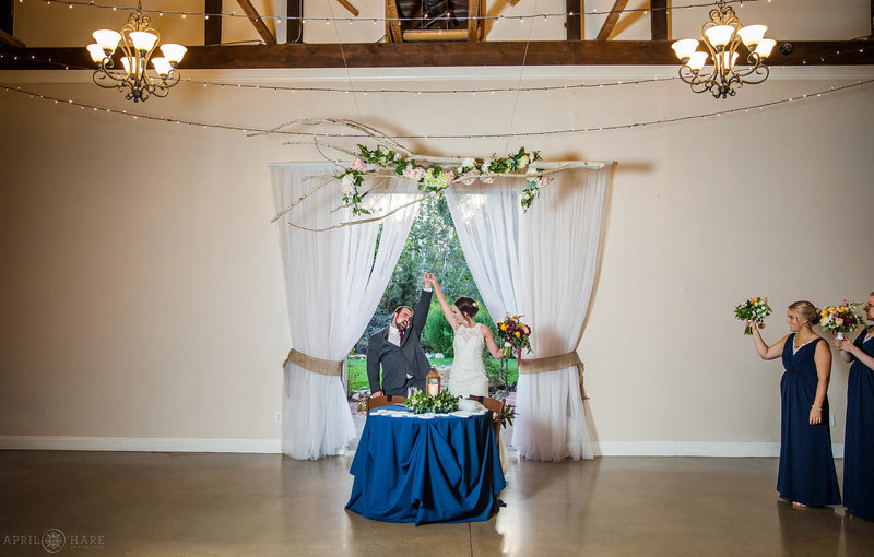 Bride and groom at their sweetheart table at Church Ranch Event Center