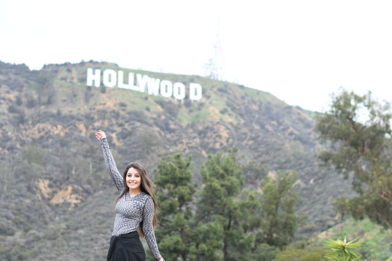 raising-arms-in-front-of-hollywood-sign