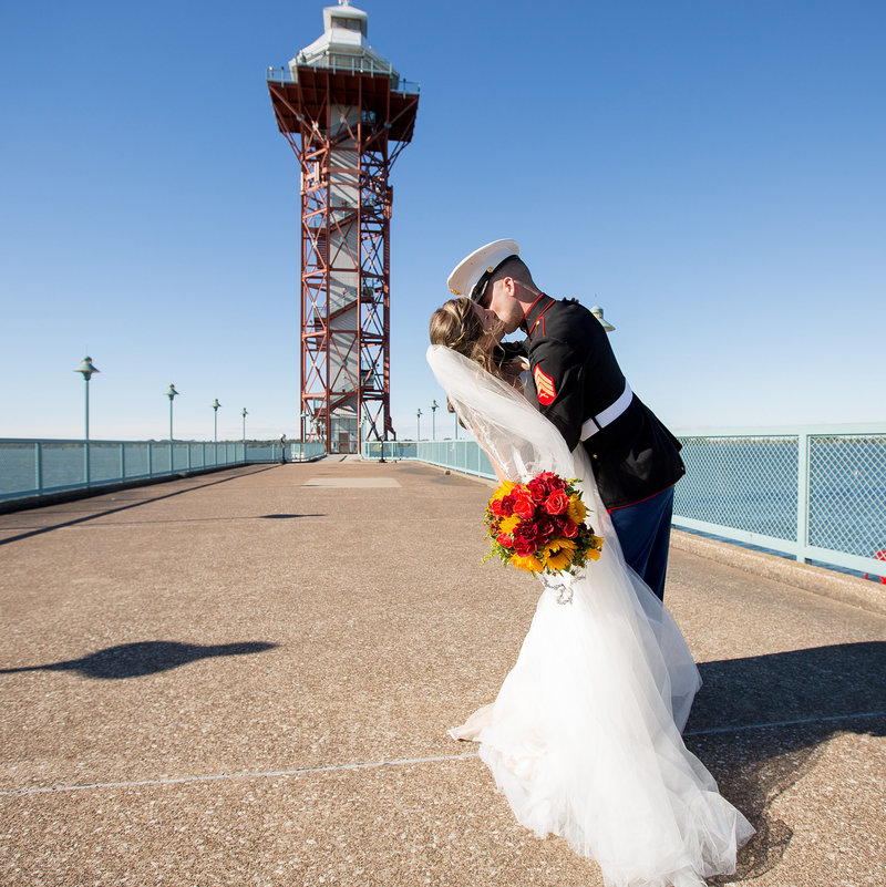 Bride and groom kiss in front of the Bicentennial Tower on Dobbin's Landing in Downtown Erie, PA