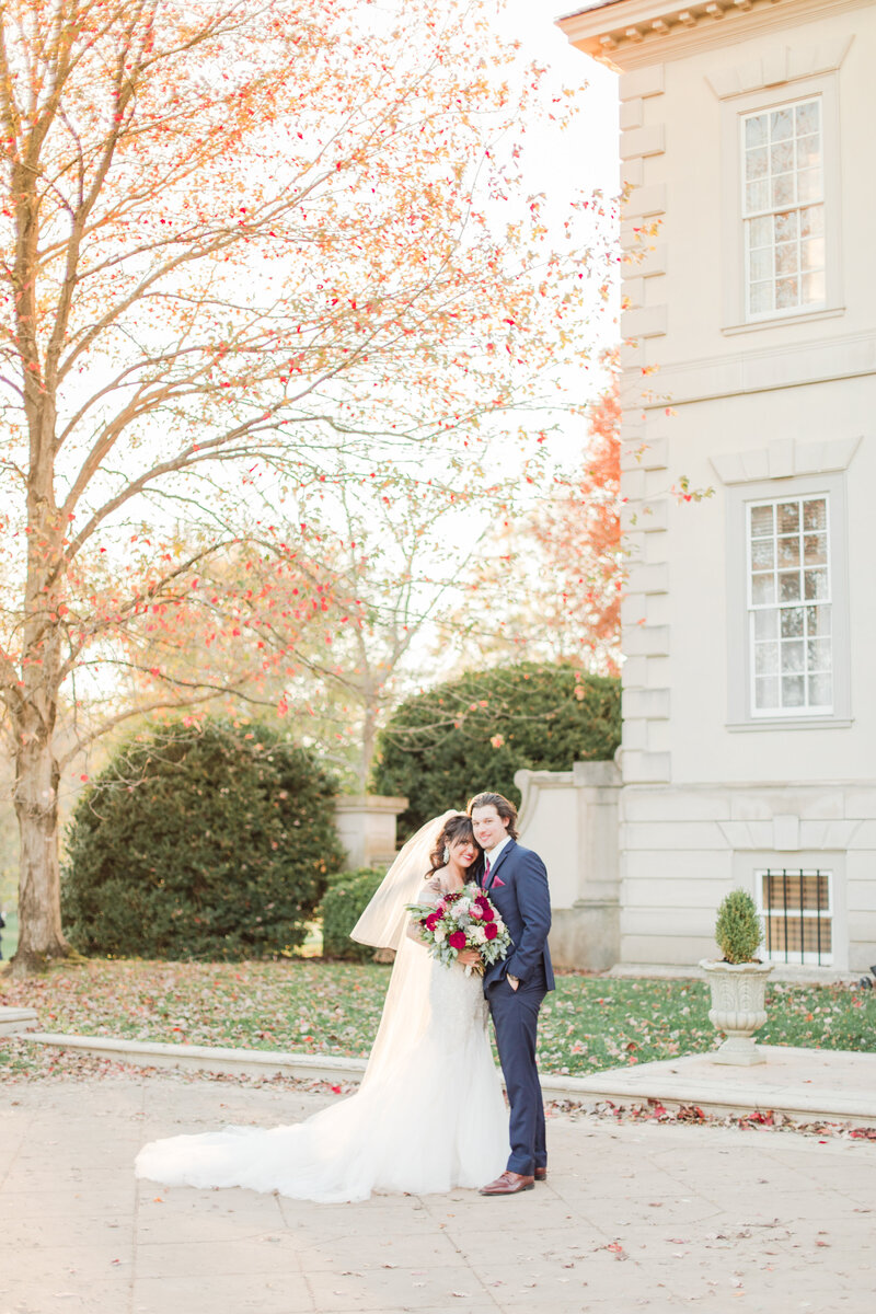 bride and groom standing in front of manor at great marsh estate wedding in charlottesville virginia by costola photography