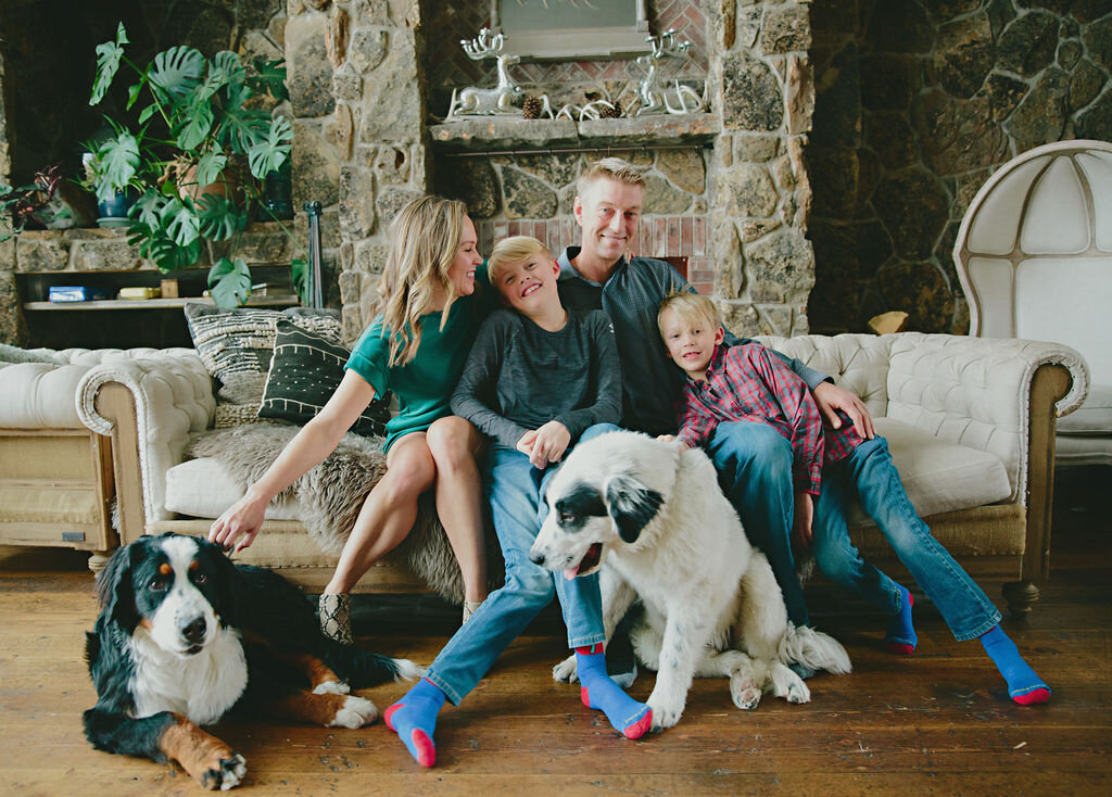 a family of 4 and their dogs in a in-home shoot